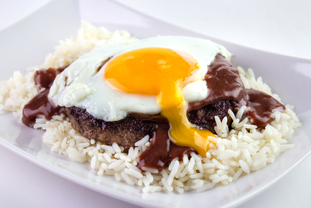 Loco Moco , traditional Hawaiian cuisine , burger patty on rice with a fried egg and brown gravy sauce