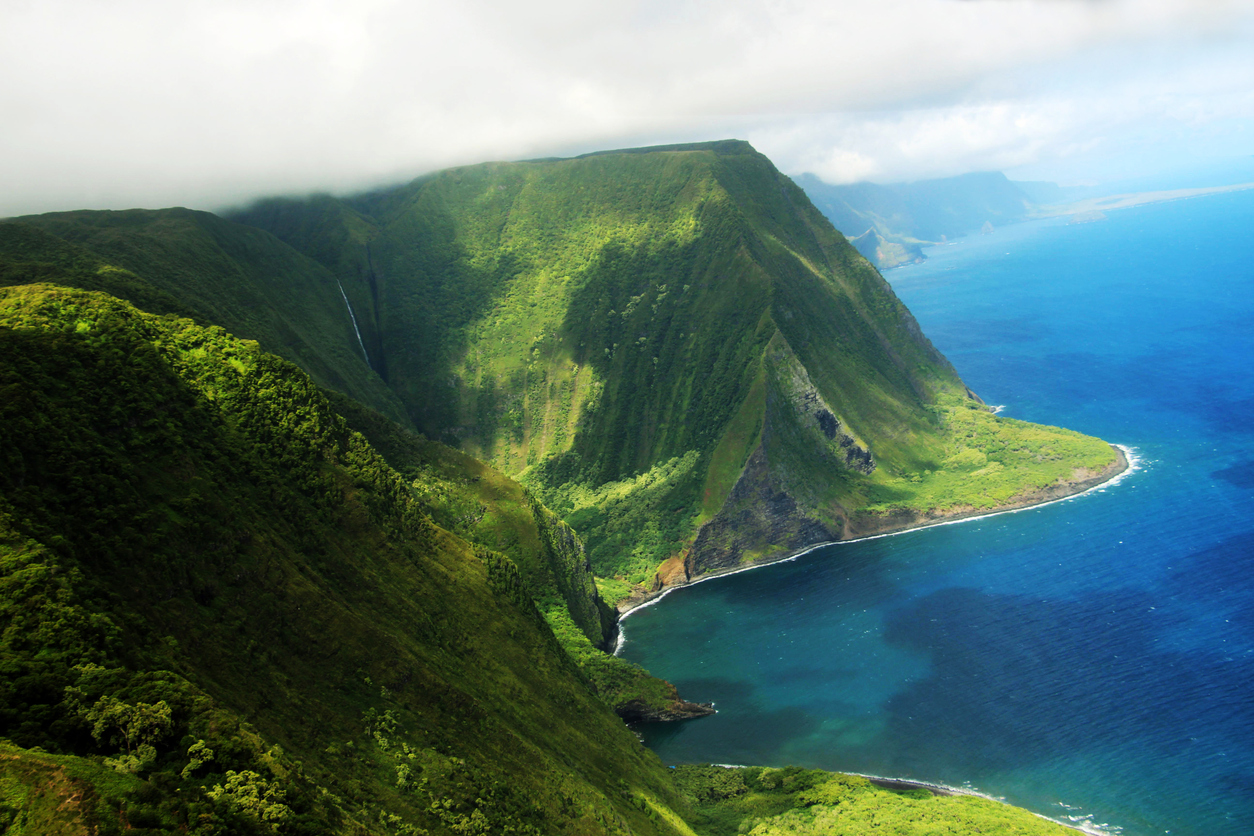 Molokai island coast and Kahiwa falls (View from a helicopter)