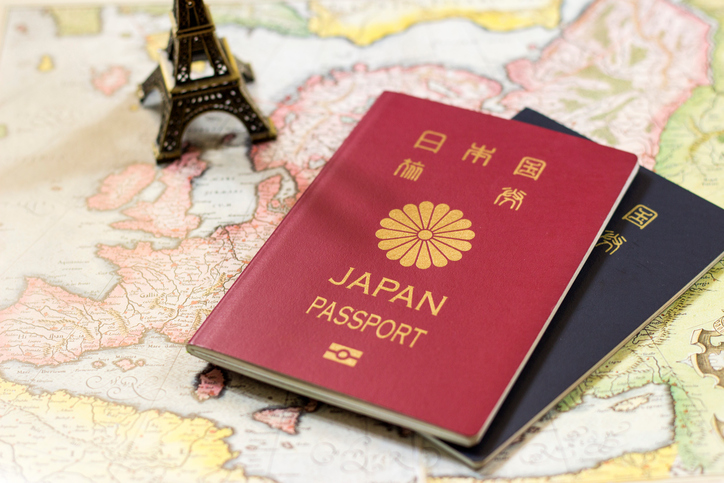 Japanese passports on the antique Europe map, retro map