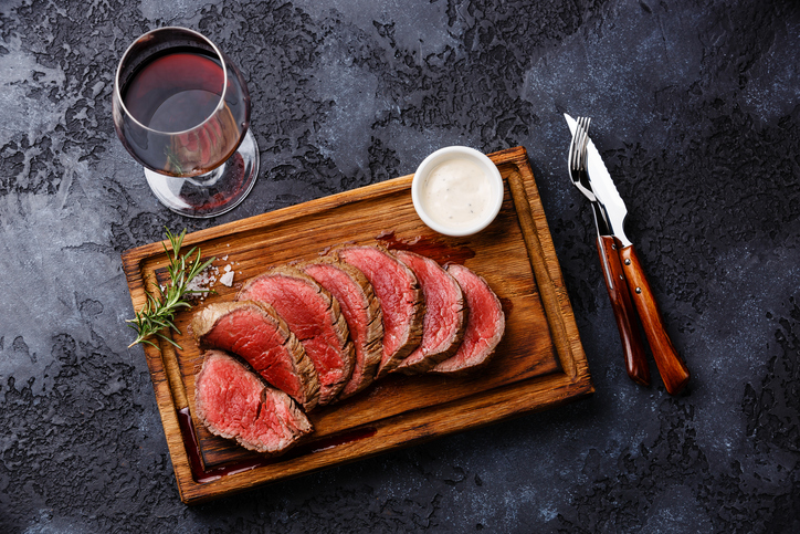 Sliced grilled tenderloin Steak roastbeef and Red wine
