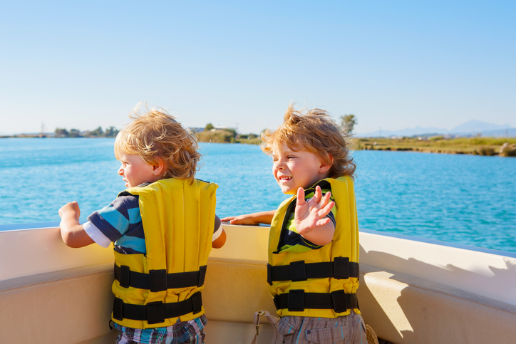 two little kid boys enjoying sailing boat trip