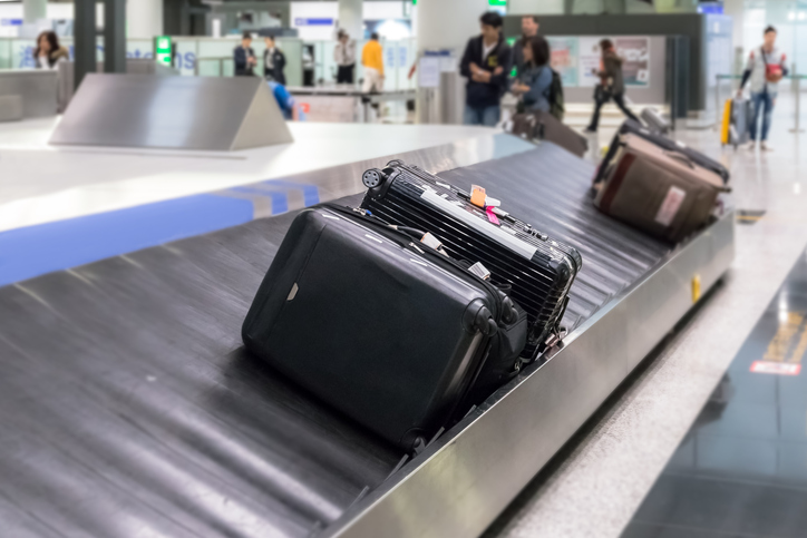 Luggage on the track blur background in airport