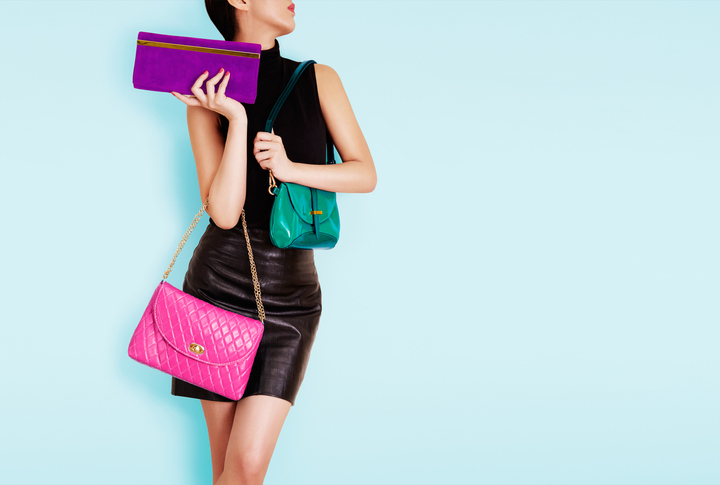 Woman holding many colorful bags. Shopping. Fashion image.