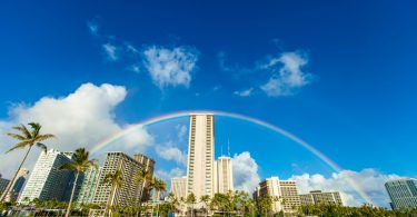 Rainbow over hotels in Waikiki Beach.