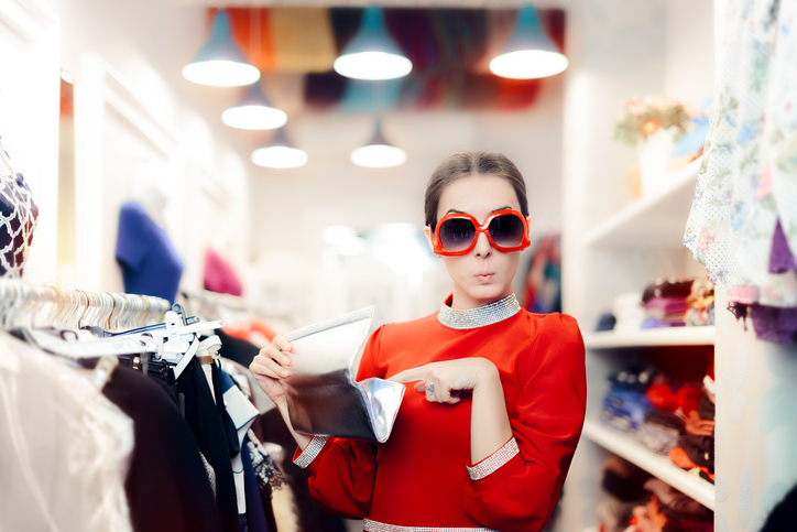 Funny Woman with Oversized Sunglasses and Silver Clutch Bag