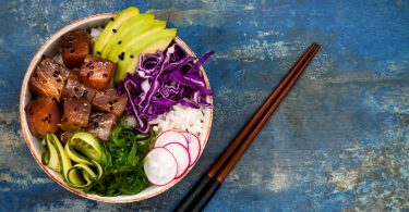 Hawaiian tuna poke bowl with seaweed, avocado, red cabbage slaw