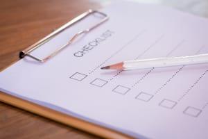Checklist concept - checklist, paper and a pen