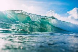 Blue wave in ocean and sky in tropics