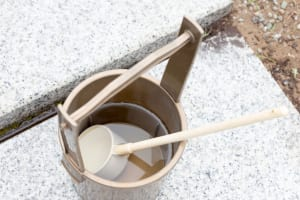 Japanese ablutionary bucket and ladle in grave yard