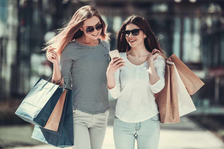 Girls doing shopping in city