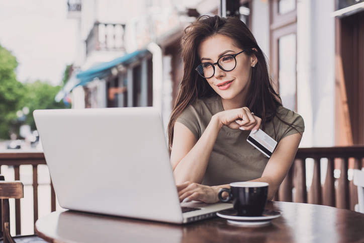 Woman is shopping online with laptop computer and credit card